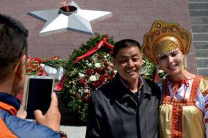 Россия: Каждому китайцу – лицензированного гида
